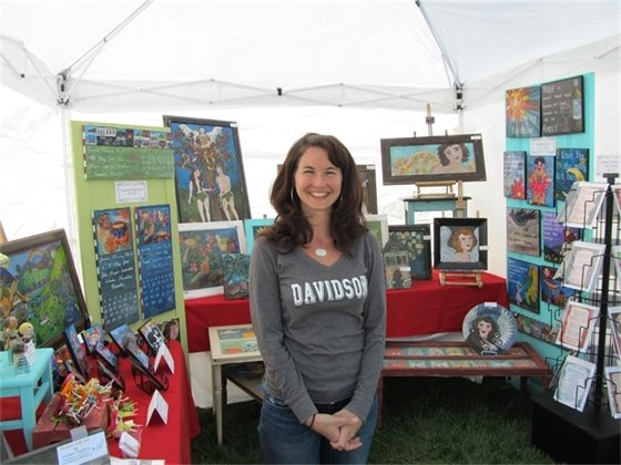 Artist Krissy Feighery in her booth on the green (photo)